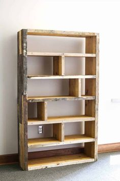 Pallet Shelves Projects How to build a DIY pallet bookshelf - Learn how to build a DIY rustic bookshelf with crates and reclaimed pallets with this tutorial and free building plans by Jen Woodhouse. Rustic Bookshelf, Wood Bookshelves, Bookshelf Design, Bookshelf Ideas, Pallet Shelves Diy, Pallet Cabinet, Book Shelves, Tree Bookshelf, Metal Bookcase