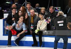 Silver medalist Yuzuru Hanyu and gold medalist Javier Fernandez of Spain pose with their staffs and coaches after the medal ceremony for the Men's Singles during day five of the ISU World Figure Skating Championships 2016 at TD Garden on April 1, 2016 in Boston, Massachusetts.