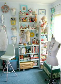 We love this bright and beautiful Sewing #Studio. Nice use of shelving for more #storage. #Sewing #Room