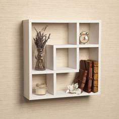 $34  http://www.overstock.com/Home-Garden/Geometric-Square-Wall-Shelf-with-Five-Openings-White/9237694/product.html Geometric Square Wall Shelf with Five Openings - White | Overstock™ Shopping - Great Deals on Danya B Media/Bookshelves