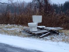 No heated seats here.  Almost looks like an art installation.  Spotted near Caroline, NY.  The Throne set on pallets, no surprises along these country roads.