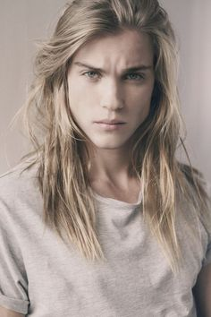 Pretty hair but the most masculine face. A unique combination: