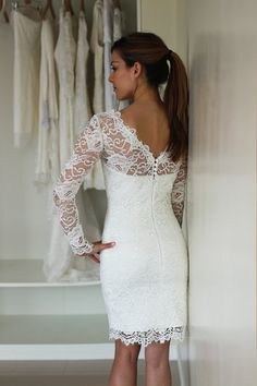 Illusion neckline short wedding dress with long sleeves made in corded French lace The dress is made in European atelier and is tailored according