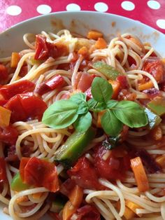 HomeMade pasta with green and red peppers, tomatoes and carrots - nice veggie dish on a lazy day