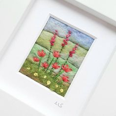 An original piece of textile art by Shropshire-based artist Maxine Smith. A one of a kind needle felted and hand embroidered miniature picture inspired by the natural environment. This little felted landscape has been created by hand using wet felting and free motion embroidery to