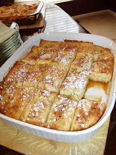 french toast bake   mix:  1/2 cup melted butter (1 stick)  1 cup brown sugar  spread in bottom 9x13 pan  one Layer Texas Toast (-crust)  Beat:  4 eggs  1 1/2 cup milk  1 teaspoon vanilla  Spoon 1/2 over 1st layer of bread.  Add 2nd layer bread.  Spoon rest of egg mixture over bread.  refrig overnight. bake 350 45min    Powdered sugar for sprinkling