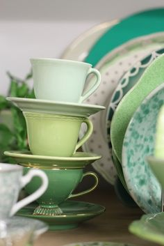 Green teacups and plates