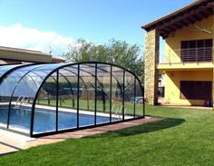 High swimming pool enclosure LAGUNA with transparent polycarbonate panels and aluminium frames.