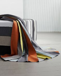 Five repeating colours are sewn together like stripes with a decorative seam so that they can be pleated together tightly and fanned out. Epiega is available in a neutral and in a bold colour setting. Bold Colors, Colours, Creations, Fabrics, Stripes, Textiles, Plaid, Blanket, Decor