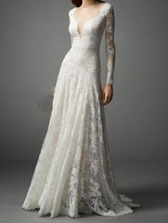 Elegant lace wedding dress with long sleeves and illusion plunging neckline and illusion open back. Processing Time Standard processing time is approx 8 weeks, peak season may be longer. If you need rush service, please contact us prior to placing your order. Size Selection This dress is available in standard size or custom size. Standard size orders please refer to our size chart. If you order your dress in custom size, measurement form and instructions will be emailed to you after your…