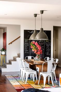 There are so many things I love about today's photo – The industrial pendant lights, the blackboard on the wall, those chairs with that table.Simply Wonderful!Source: Collected Interior…