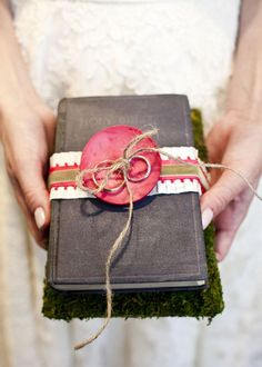 using the Bible instead of a pillow for the rings..love!