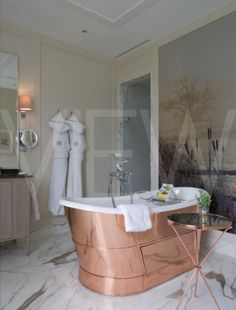 copper bath and marble floor
