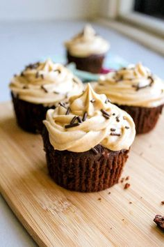 Fudgy Brownie Cupcakes piled high with creamy and rich peanut butter frosting. The best cupcake recipe for peanut butter/chocolate lovers! sallysbakingaddiction.com