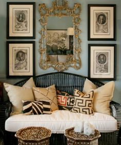 eclectic soft colours  Love the classic etchings contrasted with the ethnic fabric cushions and the inlaid tabourets.