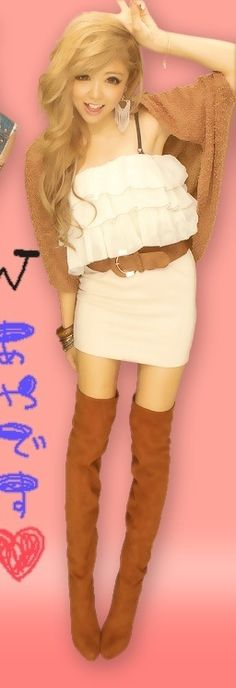 Cool, gyaru: Brown, knit bolero. White dress with frills. Light brown belt. Light brown, suede boots with heels. Big earrings. Metal bracelets.