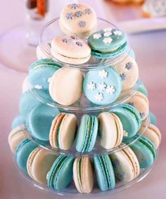 Snowflake-adorned macarons! | Frozen Winter Birthday Party