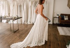 The bride is wearing the @ruedeseinebride 'Zara' gown in the boutique of Wild At Heart Bridal.