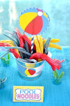 """""""Pool noodles"""" = colored Twizzlers & Sour Straws. Fun summer party candy idea."""