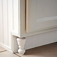 Clever idea finials as feet for kitchen cabinets