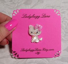 Adorable Hello kitty pin with a pink bow of course! Made with a butterfly clutch. You can put this on your purse, hat, backpack, shirt, or tie. There are so many fun uses for pins! Made with super strong glue ,she is about 1x3/4. Comes to you on a handmade card and wrapped in a organza bag.  Thanks for looking! Lisa