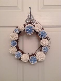 A personal favorite from my Etsy shop https://www.etsy.com/listing/493141941/10-inch-christmas-pinecone-wreath-winter