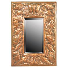 """English Arts & Crafts Mirror. Hammered Copper with Mirrored Glass. England. Circa 1905. 24"""" x 17""""."""