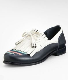 I like the Tory Burch pair best! Weird Trend We're Digging: Golf-Inspired Shoes