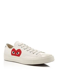 COMME des GARÇONS' Converse Chuck Taylor low top sneakers feature their unmistakable heart logo.