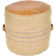 Crafted of woven jute and natural-hued leather, this vintaged pouf adds a rustic touch to any room. Set it in the den to kick up your feet after work, or pul...