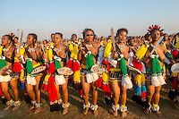 Ludzidzini, Swaziland, Africa - Annual Umhlanga, or reed dance ceremony, in which up to young Swazi women gather to celebrate their virginity and honor the queen mother during the 8 day long event. Maidens purchase snacks from across fence