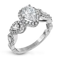 FOR THE ROMANTIC BRIDE: A pear shaped diamond ring for an engagement that sparkles