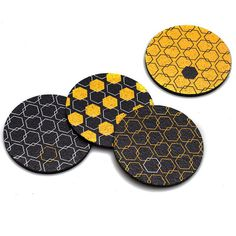 A perfect brightly designed touch to your tabletop, this set of 4 coasters features a geometric honeycomb print in a yellow and gray palette.  This unique set of 4 coasters is made from 100% recycled rubber and won't slip or scratch your surfaces. Made in the USA.