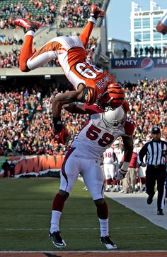 Touchdown!!! Jerome Simpson... One of the best catches in the NFL, Jerome does a front flip over #58 of the Cardinals to get the Touchdown for the Bengals. I was at this game and the stadium was Rockin, the fans could probably be heard cheering in the next state.  It was Awesome!!!!!!