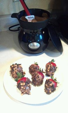 Jenny F.  dipped strawberries in Velata Caramel Milk Chocolate and then rolled in Reeses and Herseys toppings! YUM!