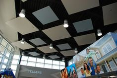 Acoustical Clouds for noise reduction hang from the ceiling of a credit union  http://acousticalsolutions.com/105~acoustics-for-design-and-privacy-at-a-credit-union