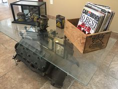 Old ford flathead we repurposed into a coffee table. Vintage 1929-39's whiz wax cans on display.