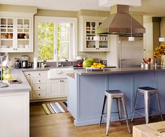Mix and Match - A colorful island adds personality to an otherwise traditional white kitchen. The blue island in this kitchen coordinates with the cool gray countertops and stainless-steel accents. Updated Kitchen, Diy Kitchen, Kitchen Interior, Kitchen Dining, Kitchen Decor, Kitchen Cabinets, White Cabinets, Kitchen Colors, Country Kitchen