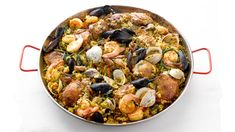 Serve this paella recipe for a feast featuring chicken, pork, and seafood in this hearty version of the classic dish. Get the recipe at PBS Food. Paella Pan, Seafood Paella, Spanish Food, Spanish Recipes, Little Neck Clams, Pbs Food, Paella Recipe, Frozen Peas, Chicken Seasoning