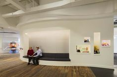 Office lobby features reclaimed wood floors and breakout space for quick meetings. Workplace design. Designed by BH+A.