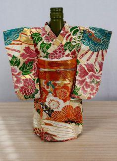 Handmade kimono wine bottle cover mad from authentic vintage Japanese Maru obi. found at www.etsy.com/shop/SACHIandCOMPANY