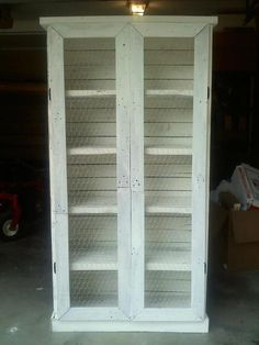 Pallet bookcase with chicken wire doors.