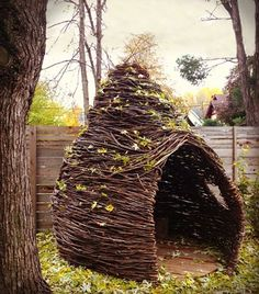14 must-see reading nook ideas, including this outdoor fort made from vines.
