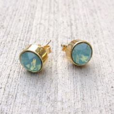 """Swarovski Crystal Stud Earings Gorgeous solitaire stud earrings with larger round Swarovski """"Pacific Opal"""" color crystal Posts are 14K gold filled and backs are gold plated. Nickel free and hypo-allergenic Jessica Elliot Jewelry Earrings"""