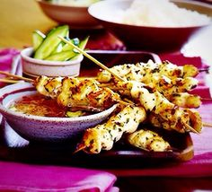 These low fat, mildly flavoured skewers are excellent served with Thai fragrant rice. From BBC Good Food Chicken Satay, Chicken Skewers, Sausage Recipes, Meat Recipes, Chicken Recipes, Recipies, Dinner Recipes, Teriyaki Tofu, Sweet Sour Chicken
