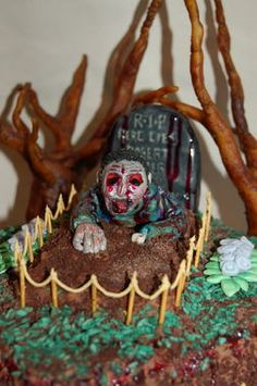 Spooky sweet zombie-rising-from-the-grave cake. Eek! http://thestir.cafemom.com/food_party/191312/14_terrifying_halloween_cakes_almost