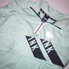 NWOT PINK Half Zip Perfect condition! Bought but never worn. It's a teal color. PINK Victoria's Secret Sweaters