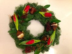 Abies wreath decorated with tulips and skimmia