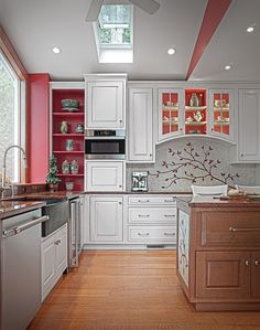 Elegant traditional kitchen cabinets with lovely red accents and decorative backsplash