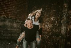 Emily and Mitch cuddled up for their engagement session at the coolest coffee shop, which had been converted from an old warehouse. We loved this space.  The exposed brick, green doors, and vintage furniture all made perfect backdrops!